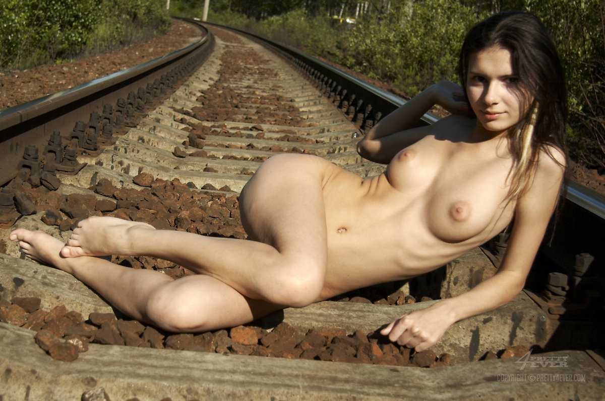 artistic female nude photos with railroad tracks